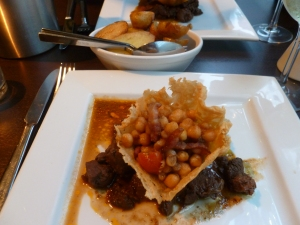 Braised Venison with Parmesan Basket and side of Sauteed Potatoes