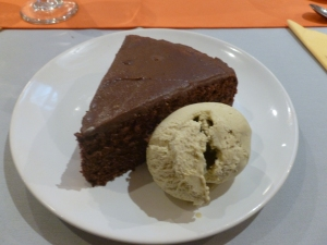 Chocolate cake and pistachio ice cream