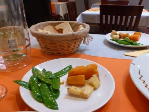 Side vegetables and bread basket